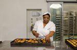 Lisbon, Portugal - January 26th, 2014: Woman making pasteis de nata in the Pasteis de Belem bakery in Lisbon, Portugal
