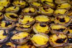 Portugese pastries, pasteis de nata in a bakery store.