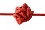 Red rope tangled up in a messy knot