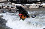 eric-jackson-professional-kayaker-practises-freestyle
