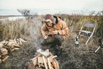 Mick Fanning stoking the fire in Alaska. Credit: Kirstin Scholtz