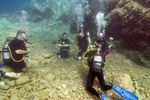 Young men underwater learning to Scuba dive